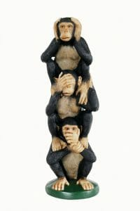 3 Monkeys stacked on top of each other signifying denial: see no evil, hear no evil, speak no evil