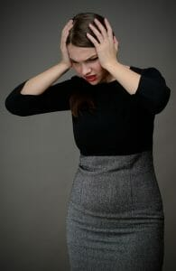 Upset woman holding her head: Don't take it personally