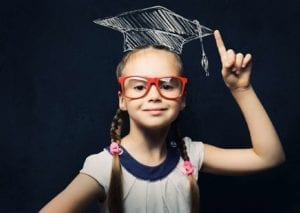 Smart young girl with glasses and a graduation cap: educate yourself