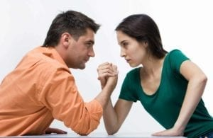 Man and woman arm wrestling - fighting with your spouse