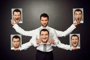 Man with 4 extra arms holding pictures of himself with different emotions on his face. Mixed emotions.