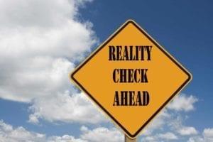 "Yellow Caution Sign Saying, ""Reality Check Ahead."""