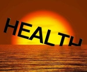 "The word ""Health"" going down into the ocean in the sunset signifying declining health"
