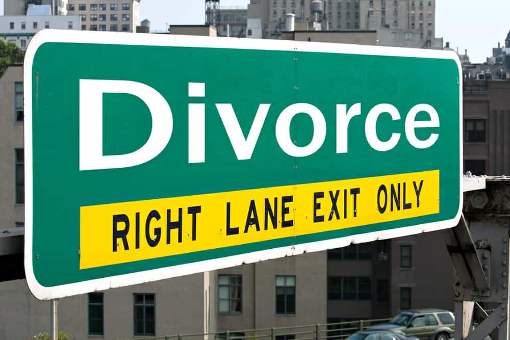"Green road sign saying ""Divorce: Right Lane Exit Only"" Your divorce is final."