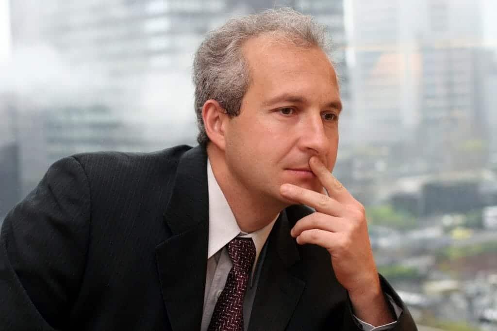 Pensive businessman deciding about the collaborative divorce process