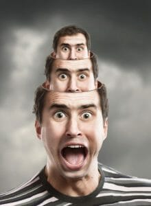 Screaming man with smaller heads coming out of his head.