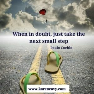 """Empty sandals on a road with the saying, """"When in doubt, just take the next small step."""""""