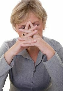 Upset woman with her hands over her face