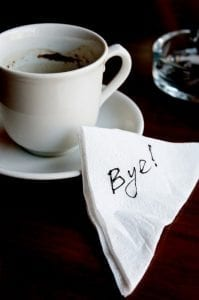 "Napkin with the word ""Bye!"" on it next to coffee cup. Divorce after a trial separation."