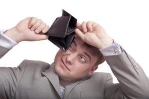 Man peering into empty wallet wondering if alimony is tax deductible