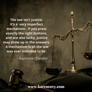 Scales of justice with saying that the law isn't justice.