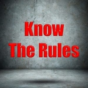 """Know the Rules"" in red letters in a stark room"