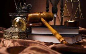 Illinois Divorce Process - Picture of law books, gavel, clock, scales of justice etc.