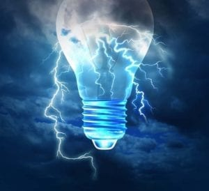 Lightbulb superimposed ona the outline of a face over a stormy sky signifying making a decision with a decision coach.