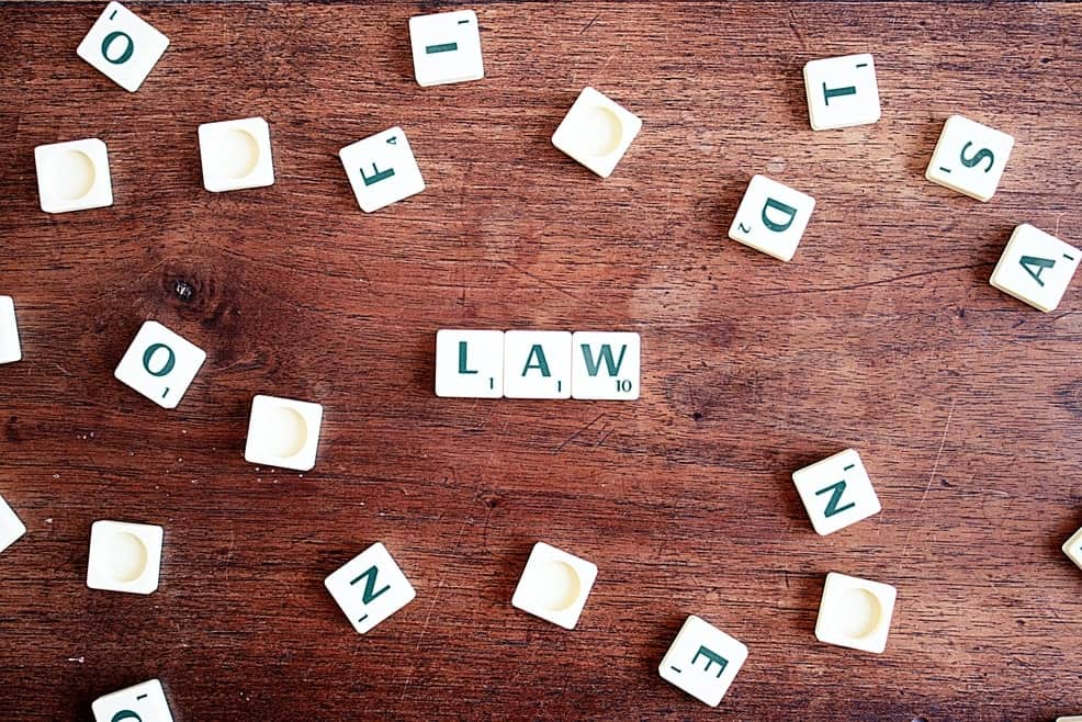 """Scattered Scrabble Letter spelling """"Law"""" and signifying here the Universal Laws of Divorce."""